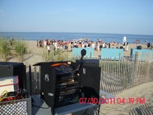 behind-dj-booth-beach-wedding