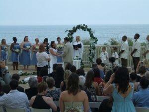 bride-groom-holding-hands-at-alter-golden-sands