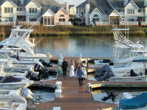 bride-groom-walking-down-dock-for-wedding