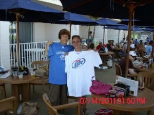 friends-holding-up-miller-lite-shirts